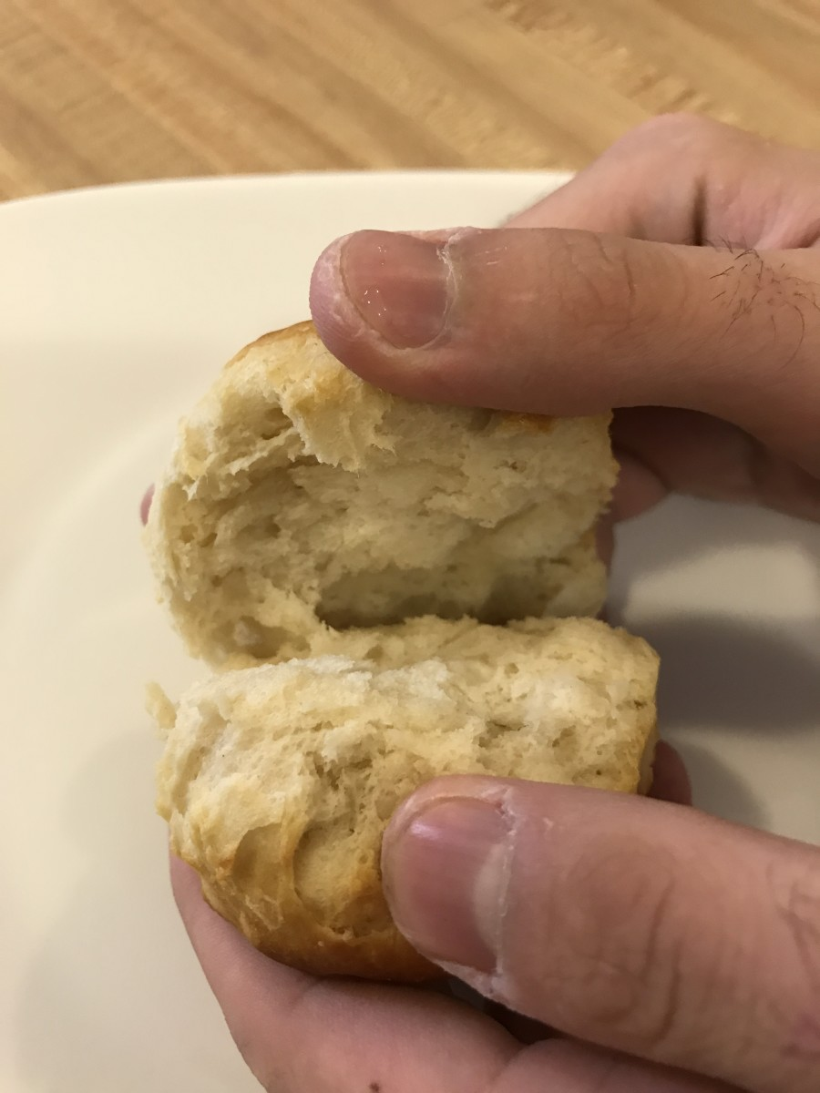 "This is my son's hand, because he was stalking the sausage gravy while I was still trying to take pictures. He probably checked if it was done and asked ""is it ready, yet?"" 548 times."