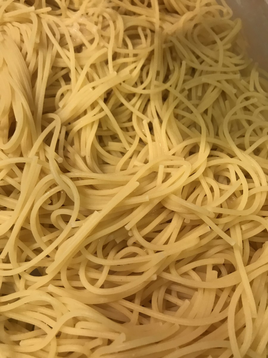 Butter a 9x13 inch baking dish, and transfer the cooked noodles to it. Preheat the oven to 350F.