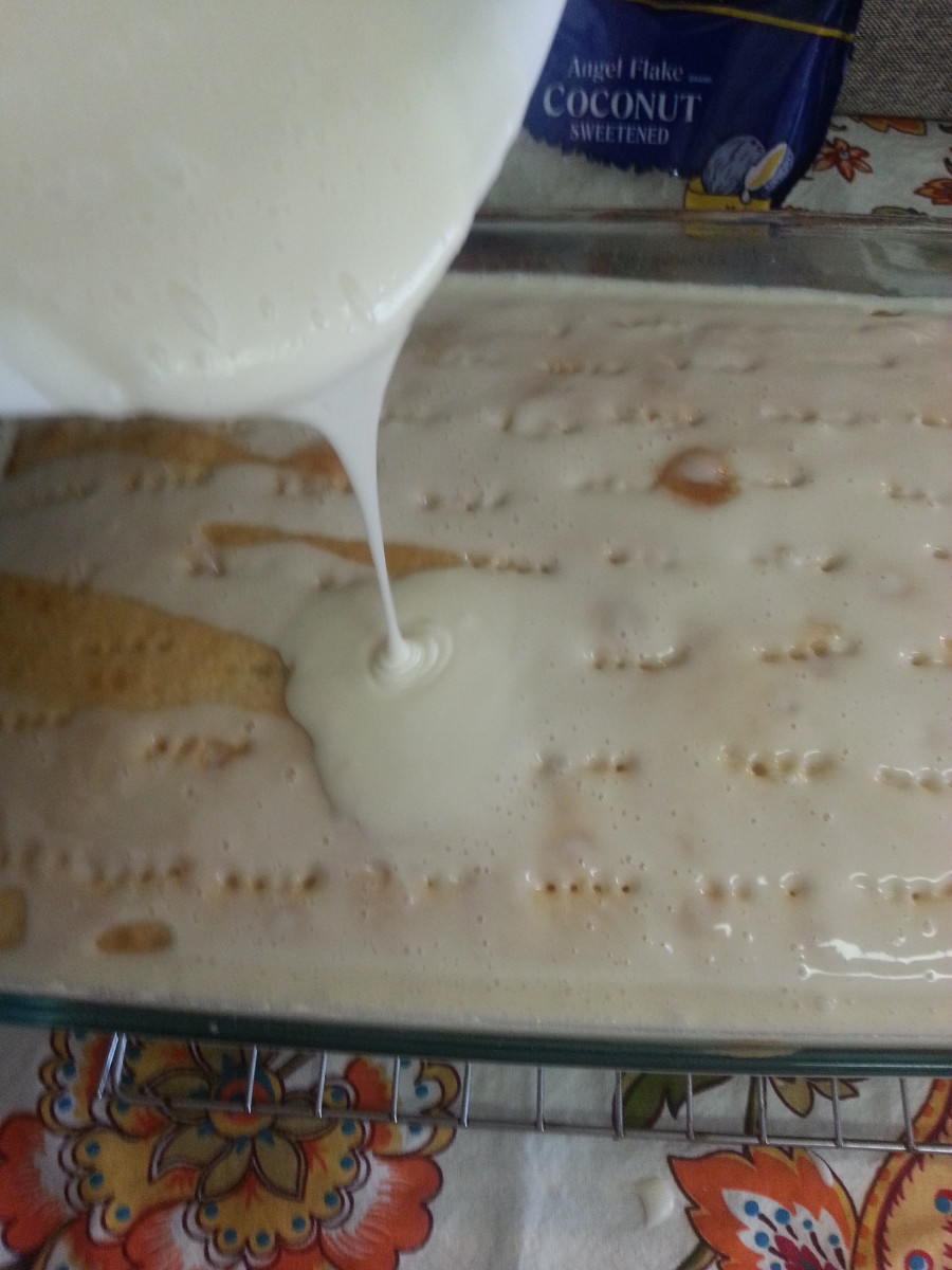After mixing the real cream of coconut milk with the sweetened, condensed milk, it is time to pour it over the warm cake with holes poked into it.