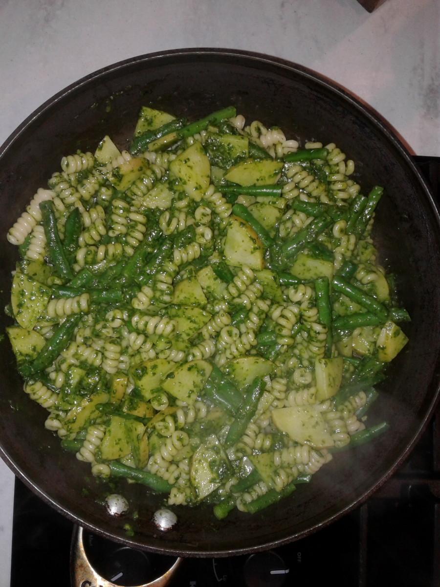 Add the pesto and stir.