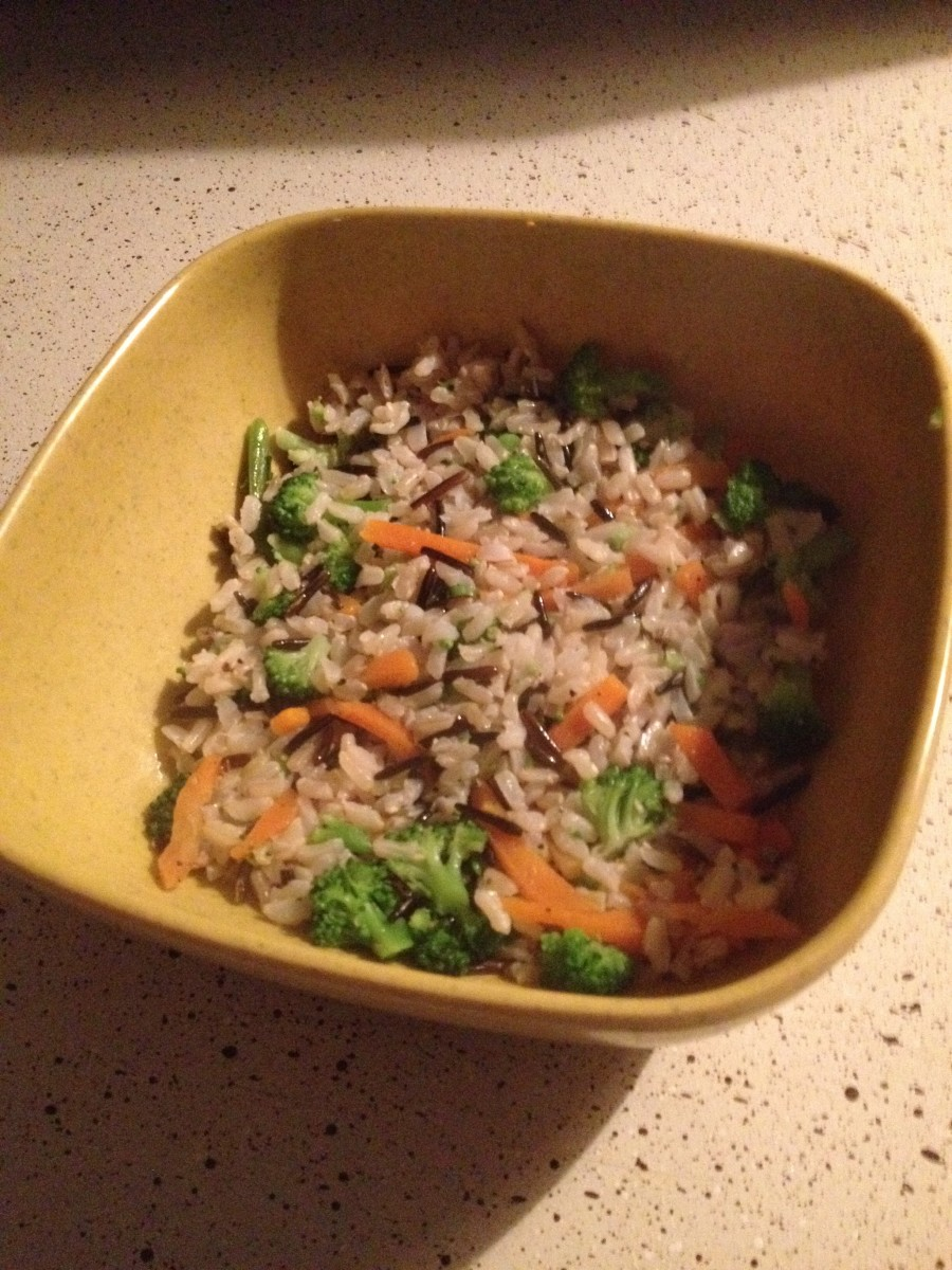 1st Layer: Brown Rice.  *Note: I added leftover veggies to add color and flavor. The more vegetables, the more nutritional value, the better!