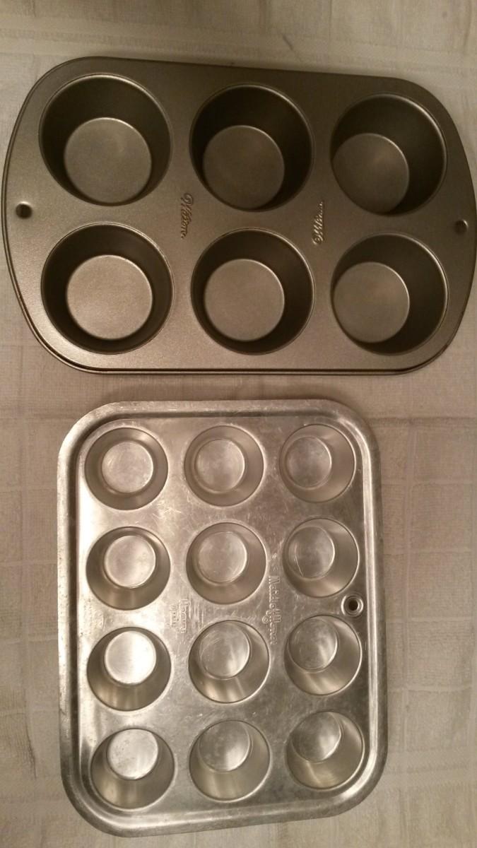 A regular-size muffin pan and a mini muffin pan.