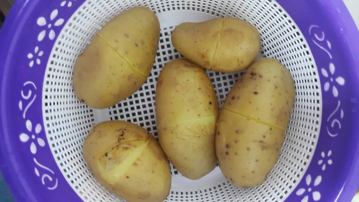 Slits made in potatoes for easy boiling and peeling.