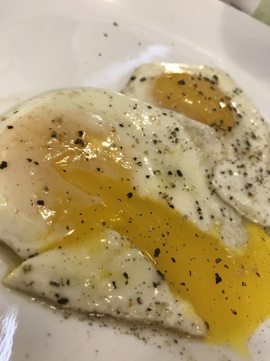 A perfectly cooked, sunny-side-up egg. Tender, well done whites, a warm, runny yolk, and perfect pepper!