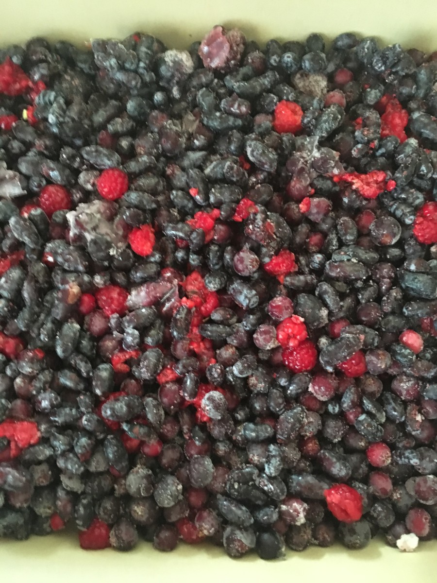 Layer the berries evenly across the pan.