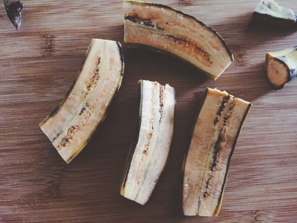 Cut the banana half, and then cut across into chunks.