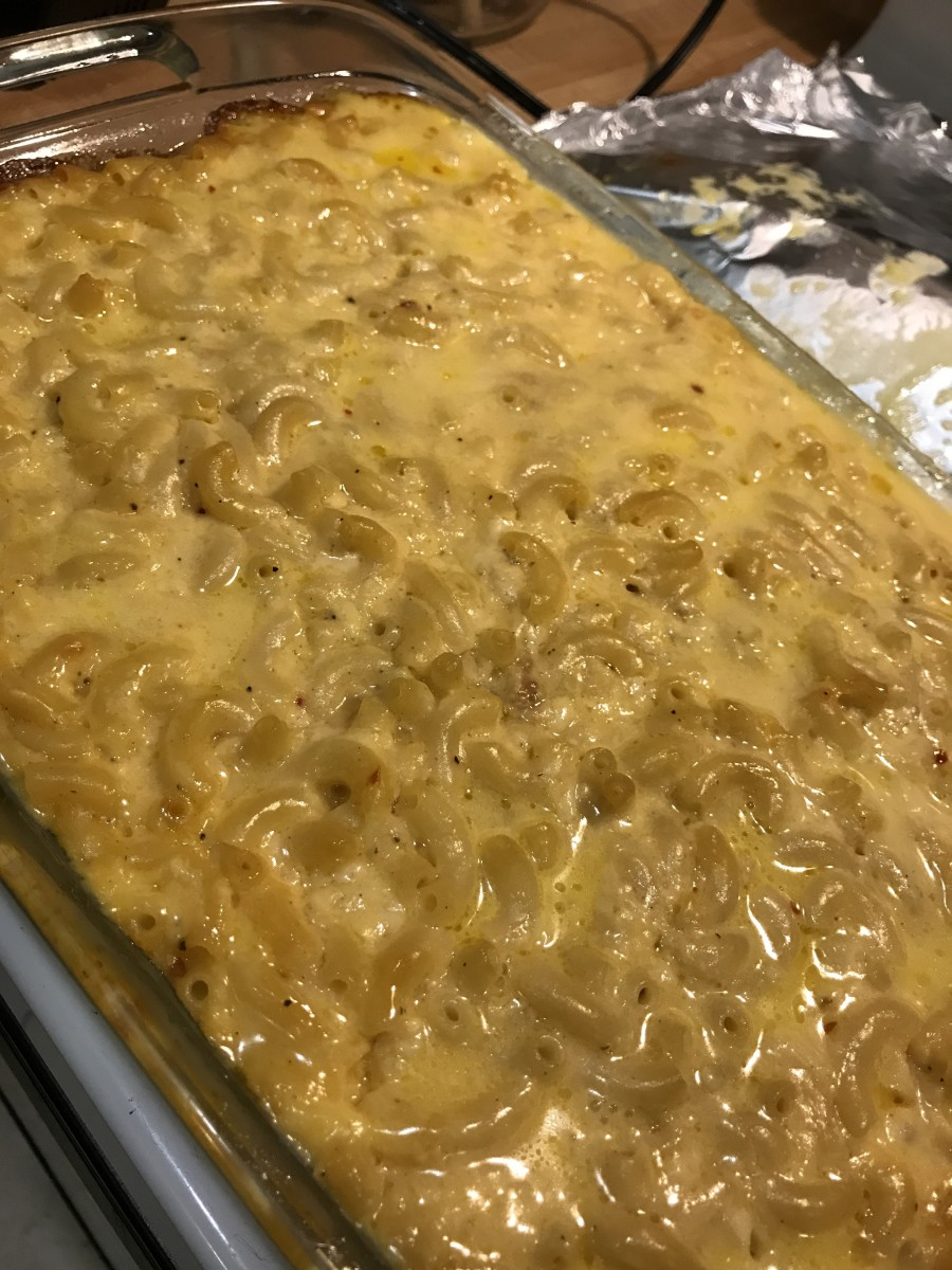 The baked macaroni and cheese hot out of the oven. If you serve it immediately, it will be a little bit loose. If you let it rest for about 10 minutes, it'll tighten up. Either way, it's molten hot - so be careful!