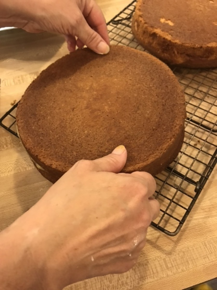 Once the bottoms have been spread with the lemon curd filling, replace the cake tops. Try to place them in the same direction as they were cut - this keeps the layers more even.