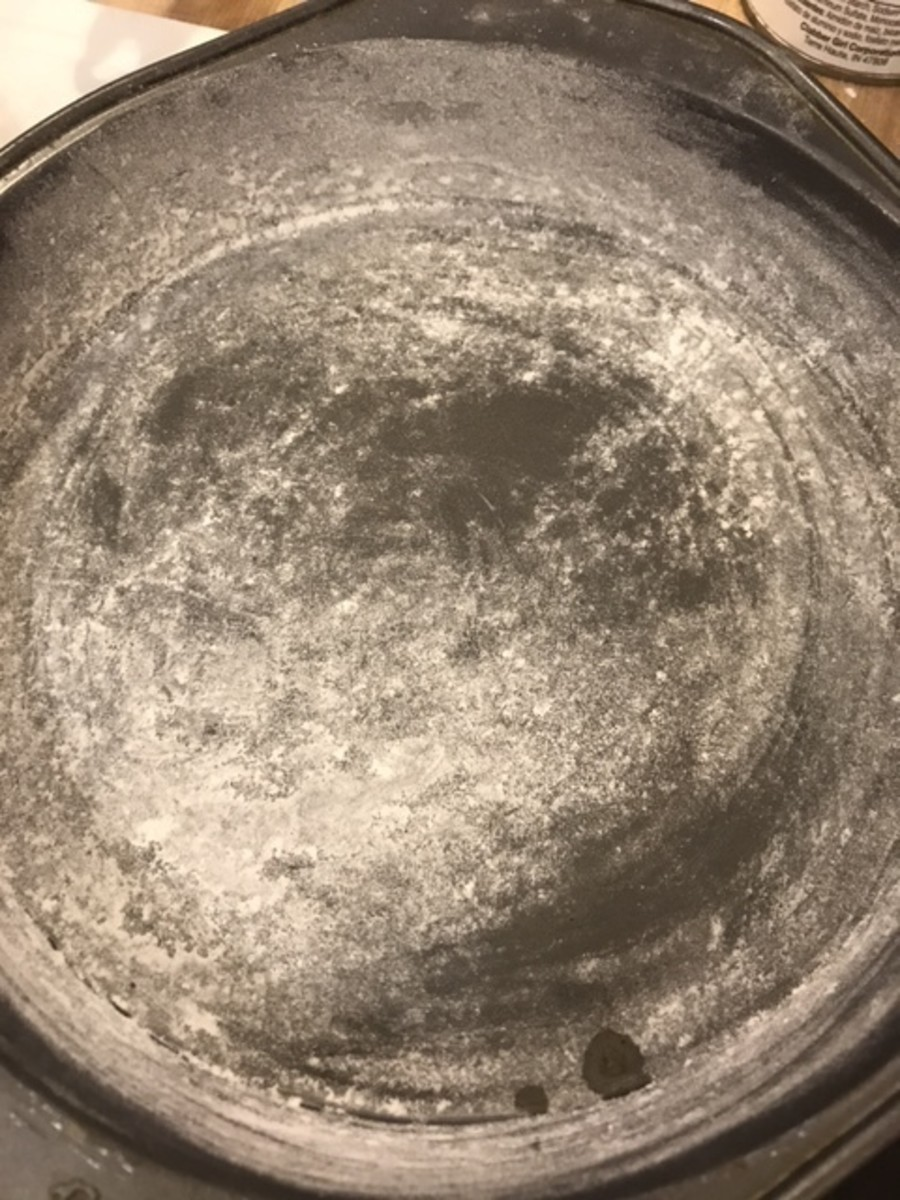 Take time to really get an even coating of butter on the cake pans, and tap out excess flour. This keeps the batter from sticking to the pans as the cakes bake.