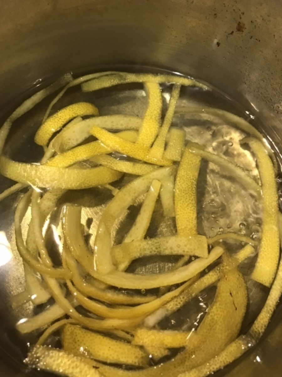Bring the lemon peel, sugar and water to a boil, reduce to a simmer, and simmer for about 20 minutes. It'll depend a bit on how thick yours is cut, but you're looking for the lemon peel to turn translucent.