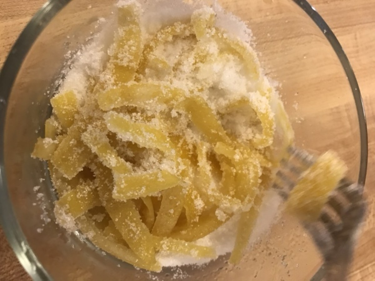 I've seen a lot recipes for candied lemon peel that tell you to mix the candied peels with the sugar by hand. I normally don't mind using my hands - but it gets everywhere! I find a fork does just as well.