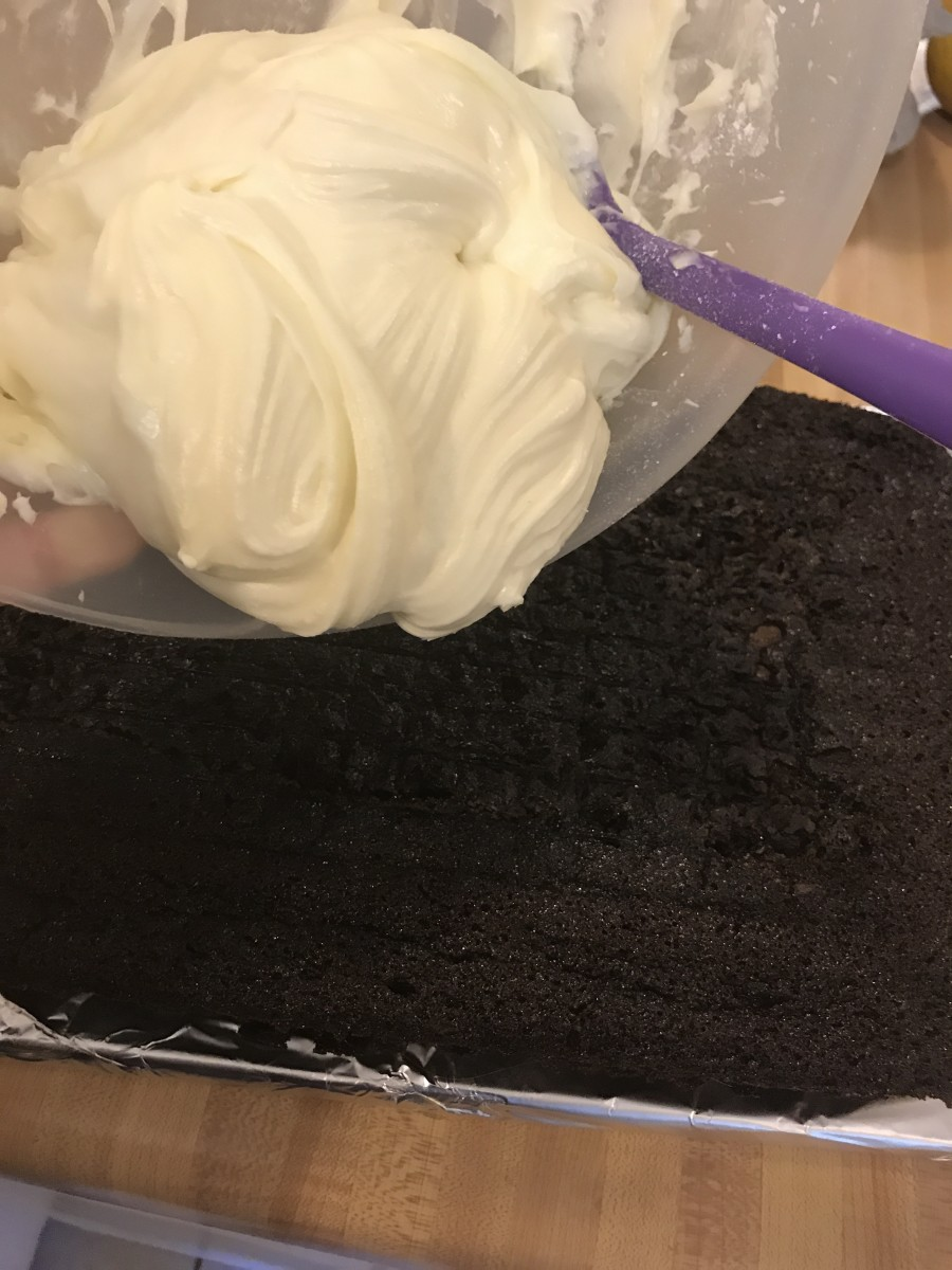 Once cooled, spread the frosting evenly over the top of the chocolate cake. You can frost the top only, or the top and sides, whichever you prefer.