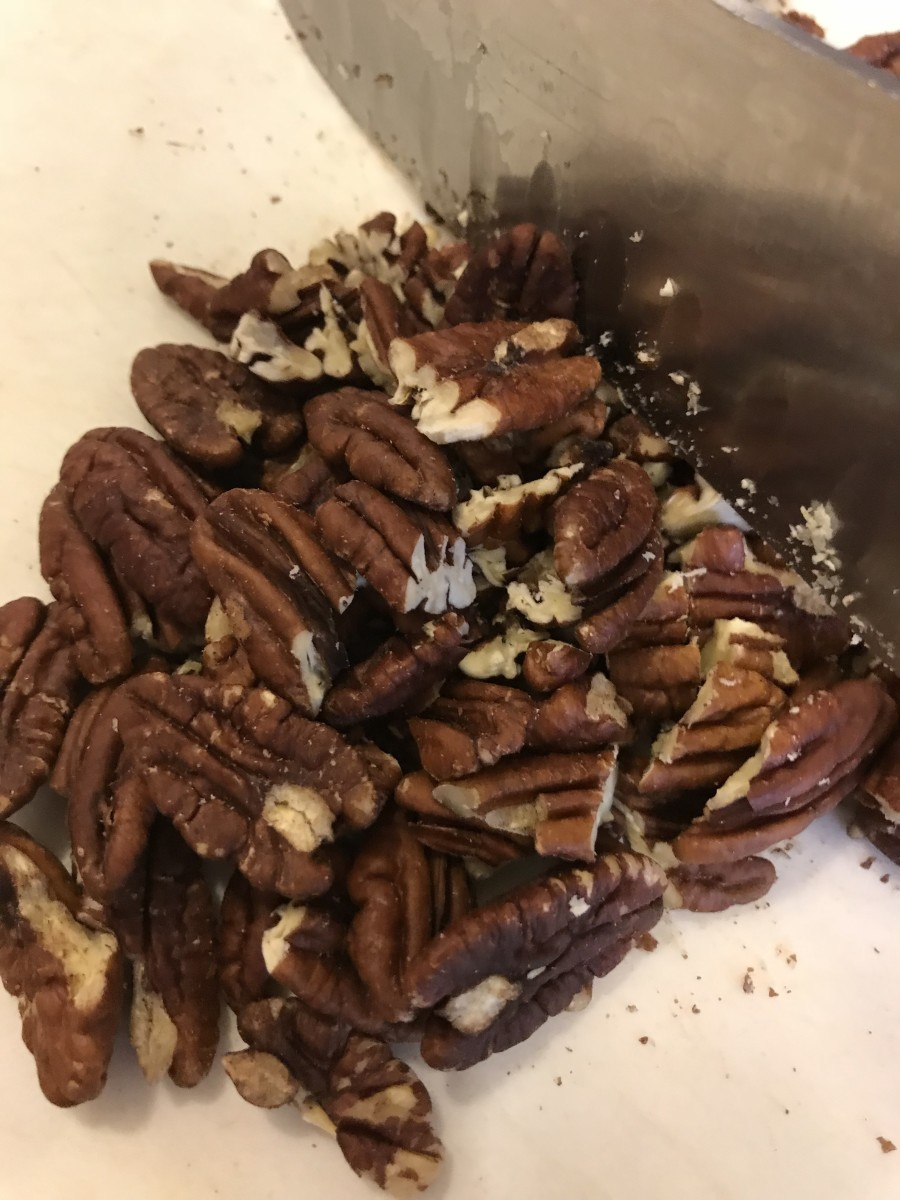 I buy pecans in bulk, so I almost always have whole pecans. If you buy them at the grocery store, you can probably get pecan pieces for less, saving a bit of money.