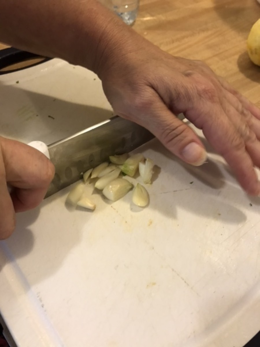 You can use a garlic press - that makes minced garlic super easy to do. Or use a chef's knife and mince by rocking the knife back and forth over the garlic several times - in one direction then back in the other.