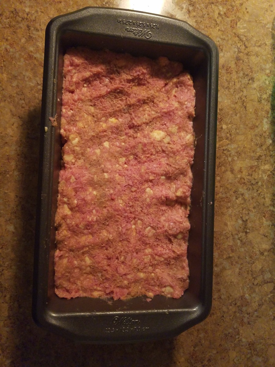 Put ground beef mixture into the loaf pan.