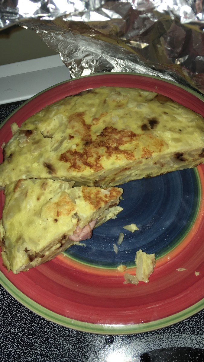 Tortilla de patata is delicious when stuffed with ham and cheese.