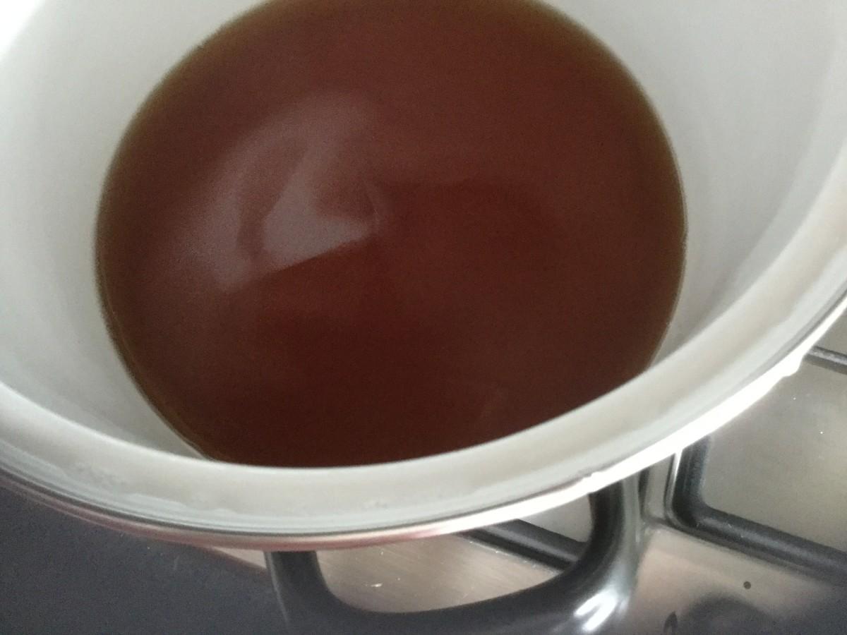 Add sugar mixture to vinegar. Cook until the sugar has dissolved.