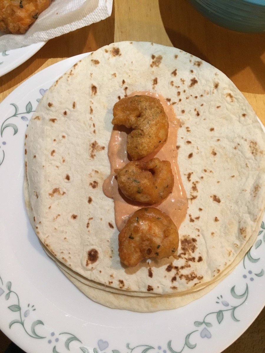 If the shrimp are still very hot use tongs to place them on the tortilla. The recipe called for three shrimp for each tortilla, but I'll admit that we added more.