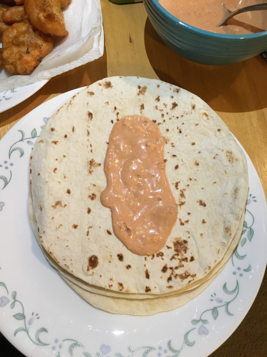 The chipotle mayo has such a nice pink color. You can smell the spices and heat when you spread it on the tortilla.