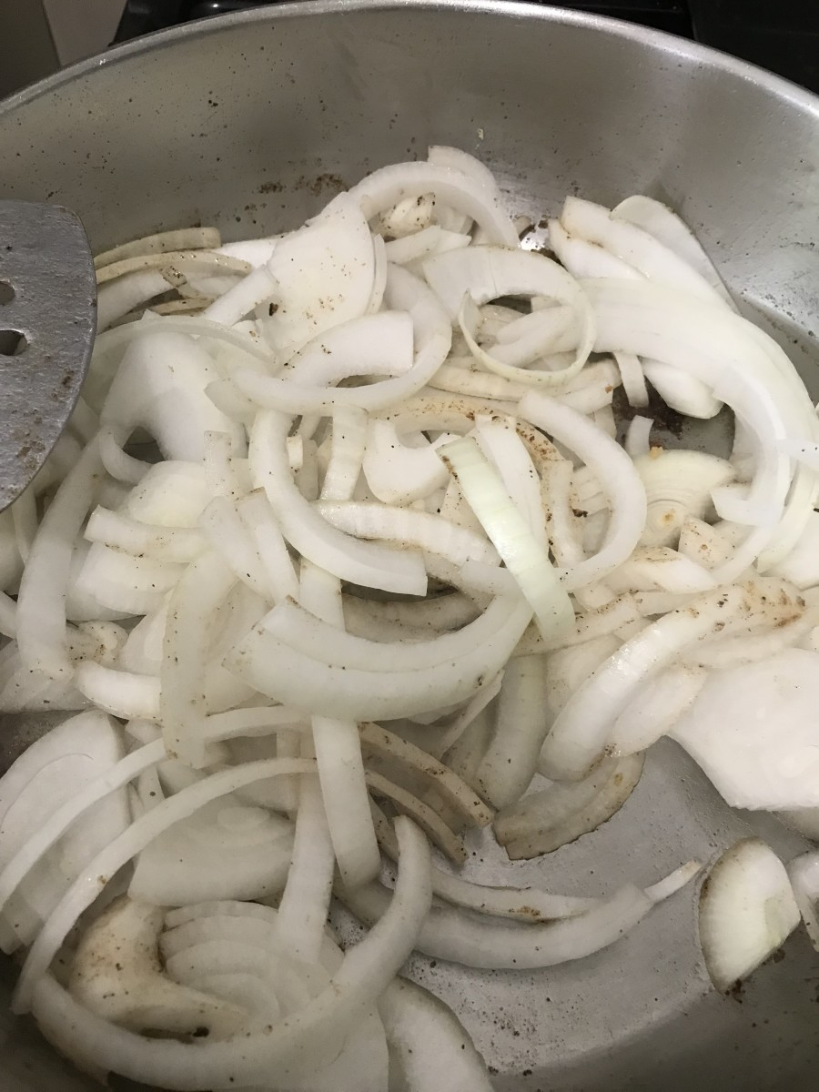 You don't have to use onions - I don't think I did in the video below. But they add a great flavor to the gravy. Start by cooking the onions in the same skillet as the steaks until they soften and become fragrant, about ten minutes.