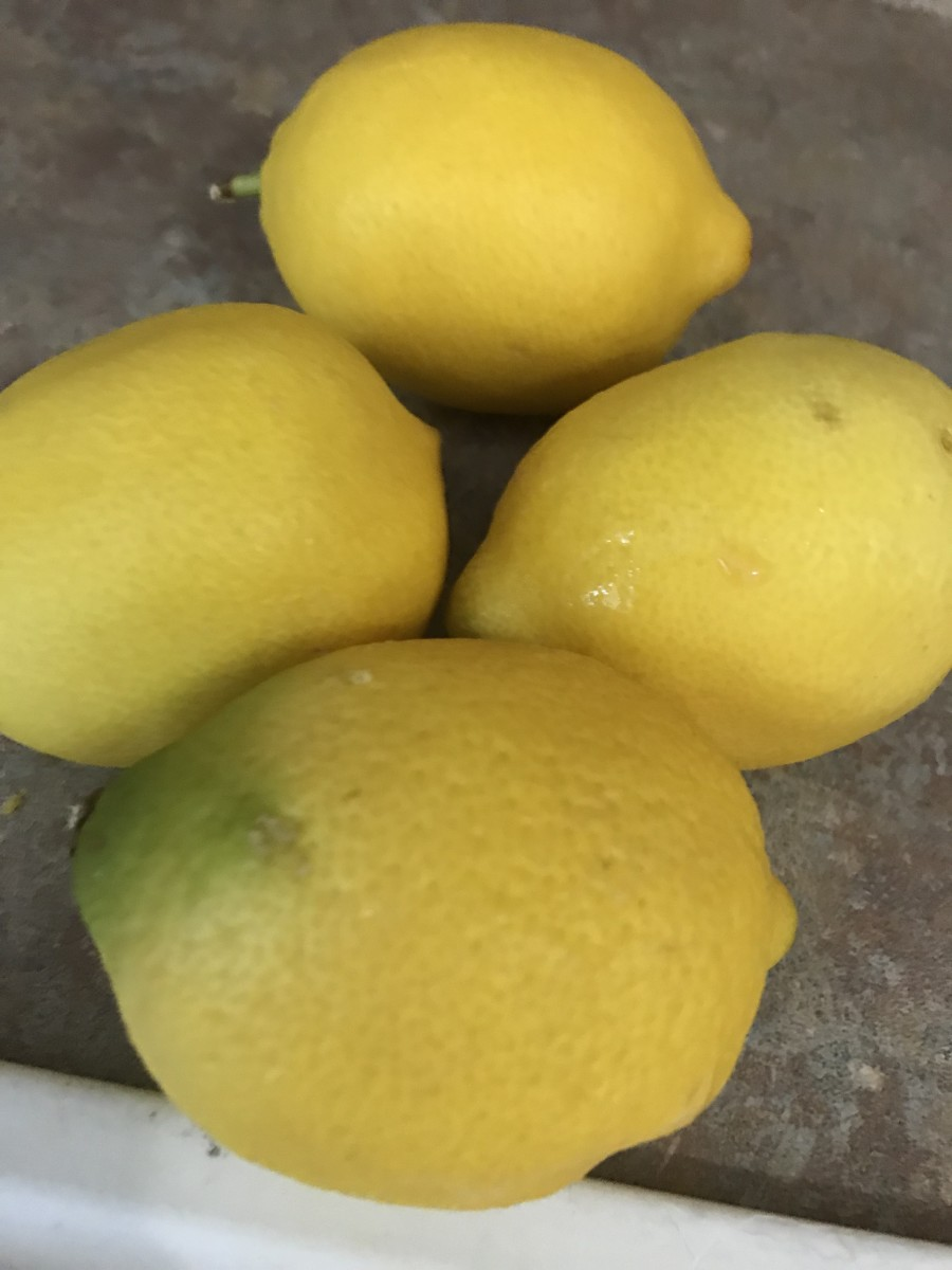 You need about 2 tablespoons of fresh lemon zest; it usually takes just at 2 fresh lemons worth of zest. I think the easiest way is to zest two lemons first, then squeeze them once you know how many you'll need to zest for the 2 tablespoons.