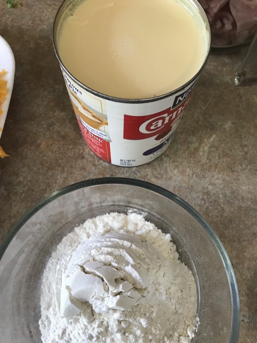 Evaporated milk and a quarter cup of all-purpose flour are all it takes to finish the bechamel. Strictly speaking, you can use another cup and a half of whole milk instead of the evaporated milk, but the evaporated milk makes the sauce nice and rich.
