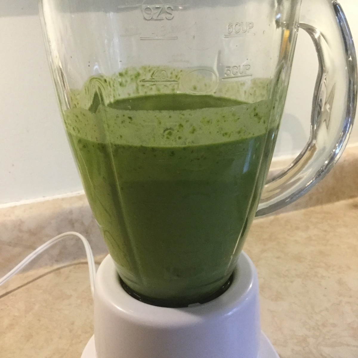 Step 2: Add the wet ingredients to the blender and puree. If your blender is anything like mine, you may have to add the spinach in batches.