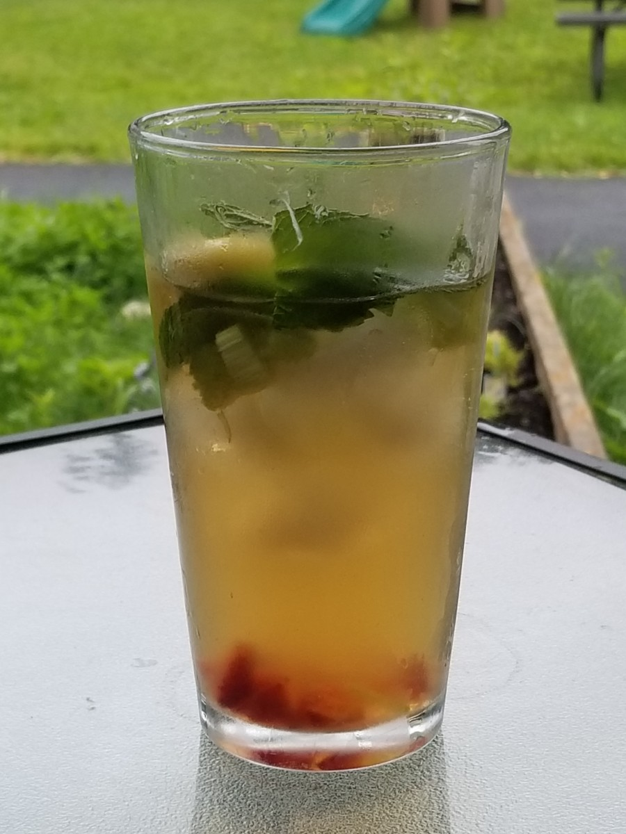 My home-brewed iced sun tea garnished with mint, strawberry and rhubarb
