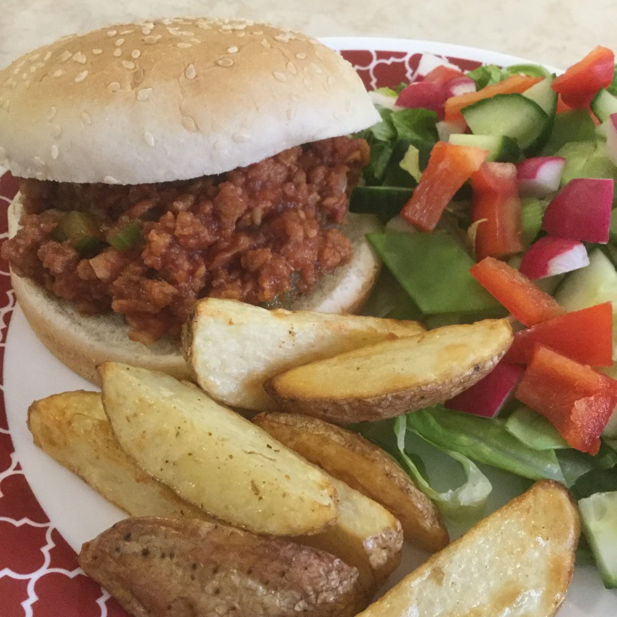 Vegan Sloppy Joe's, served with potato wedges and a green salad.