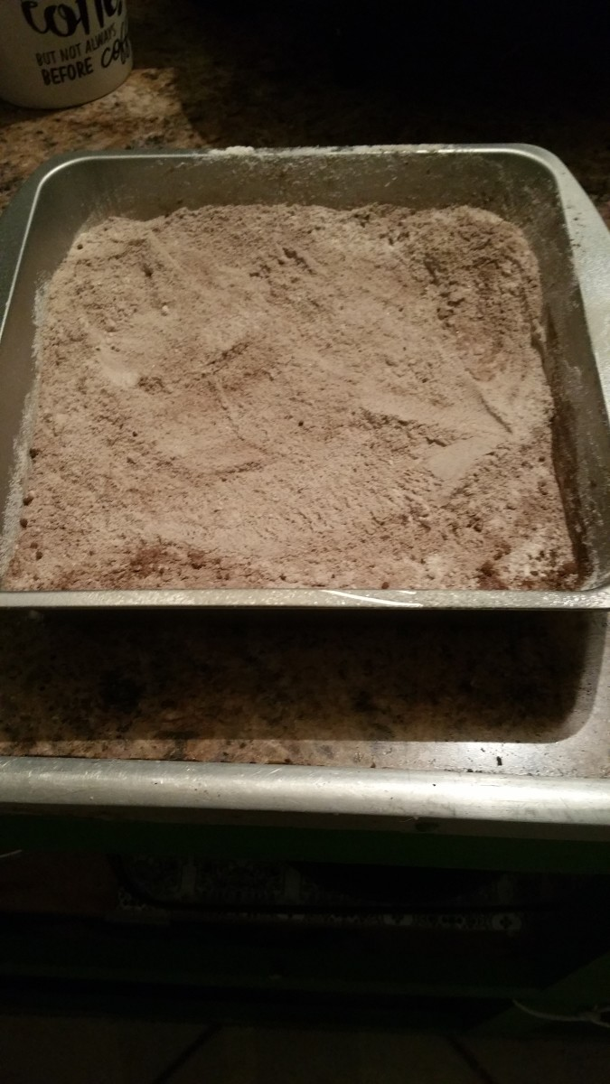 In an 8-inch greased baking dish, combine and mix together the flour, baking cocoa, sugar, baking soda, and salt.