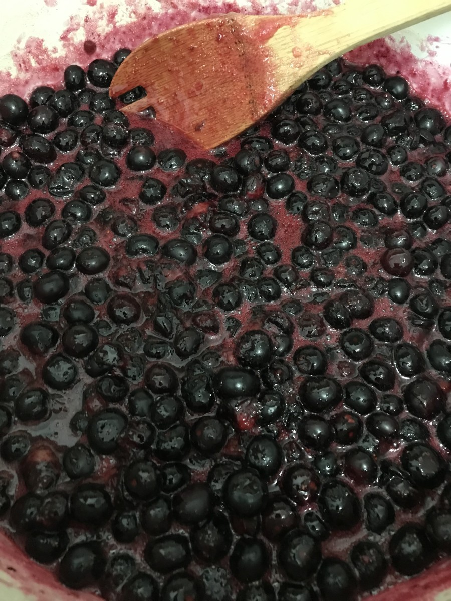 Let your blueberries simmer for about half an hour. You won't need to add pectin, cornstarch, or other thickening agents. They blueberry jam will thicken up on its own.