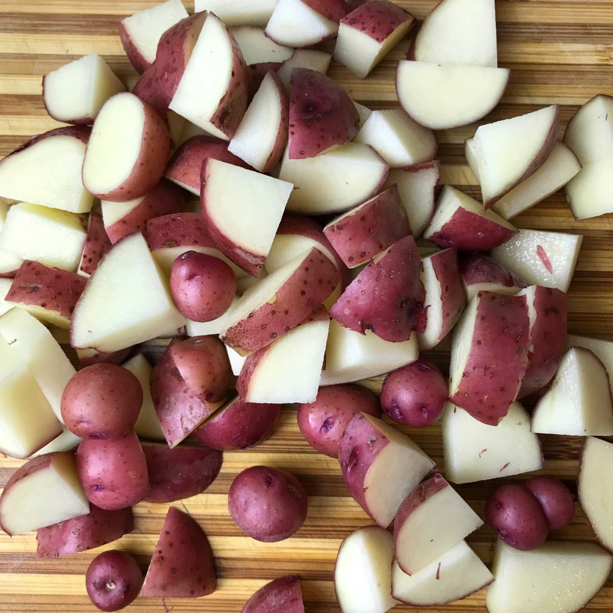 Quarter the potatoes and cut into medium bite-sized pieces. If you have teeny-tiny potatoes like I did, you can leave them whole.