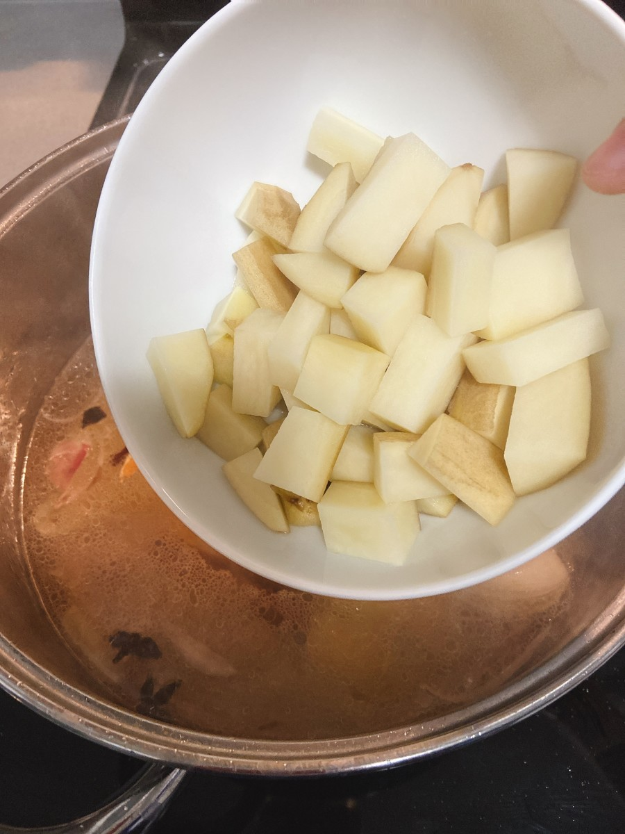 Add the boiled potatoes into the broth.