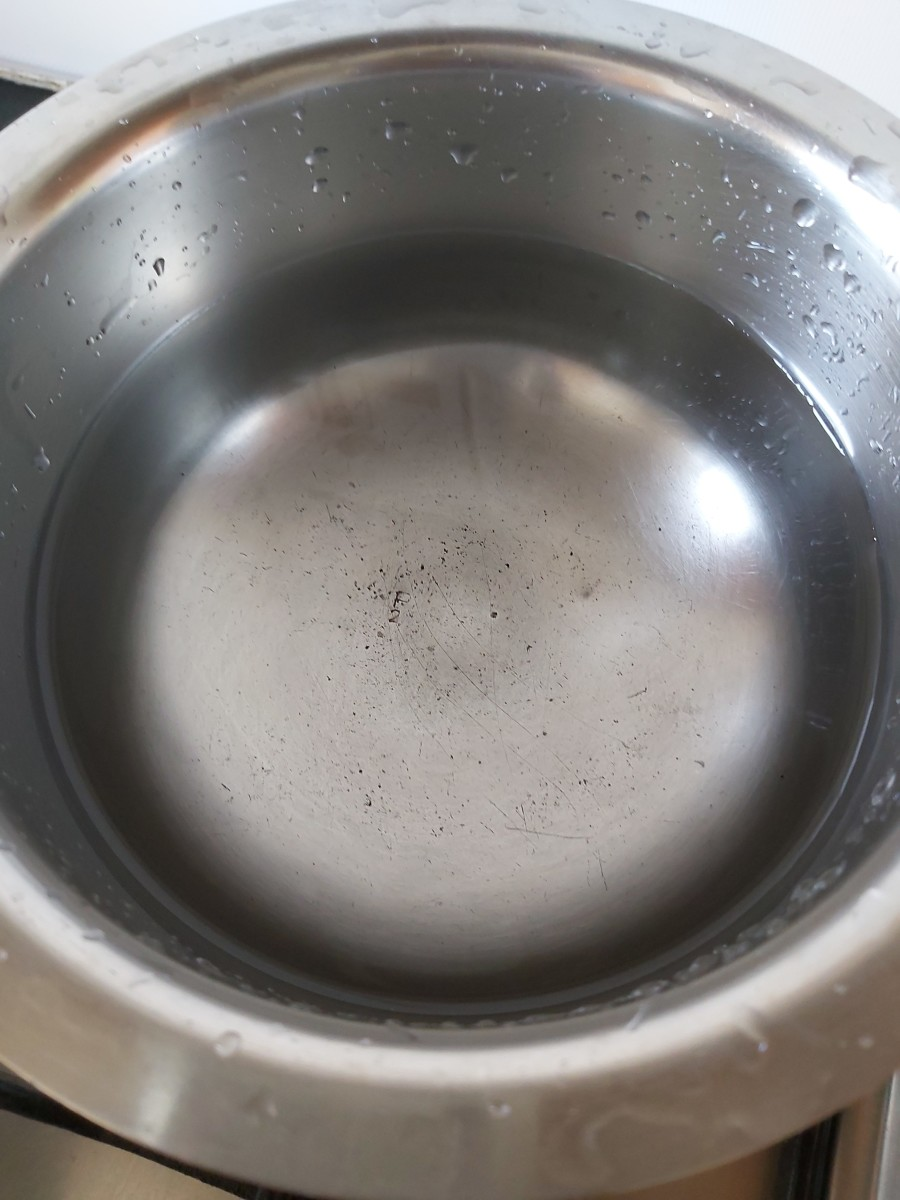 In a vessel or kadai, add 2 cups of water bring to a boil.