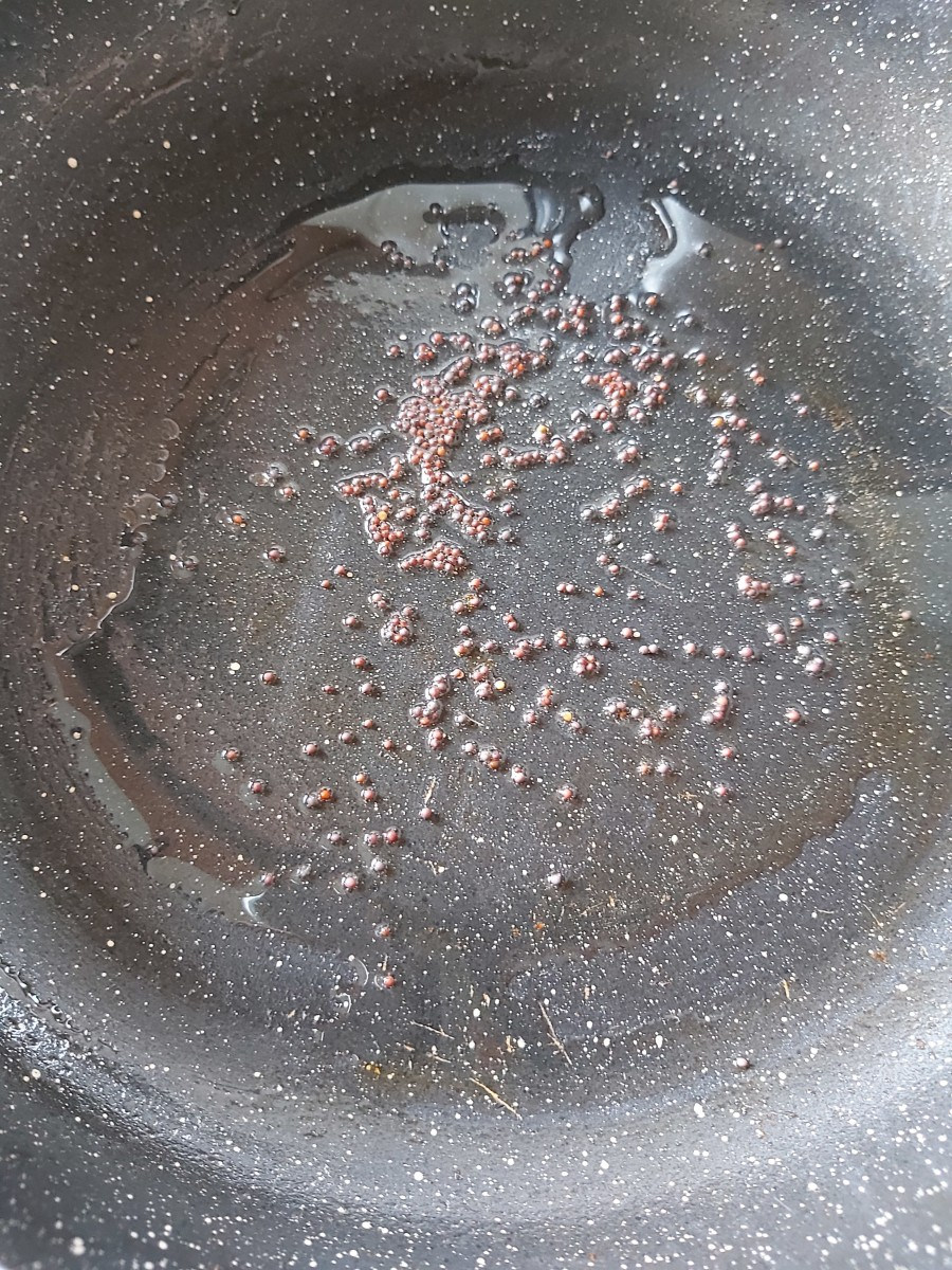 In a pan, heat the oil and splutter the mustard seeds.