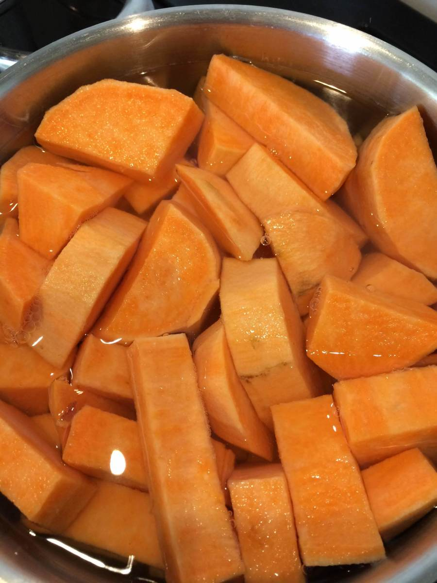 Peeled and chopped sweet potatoes, ready to cook.