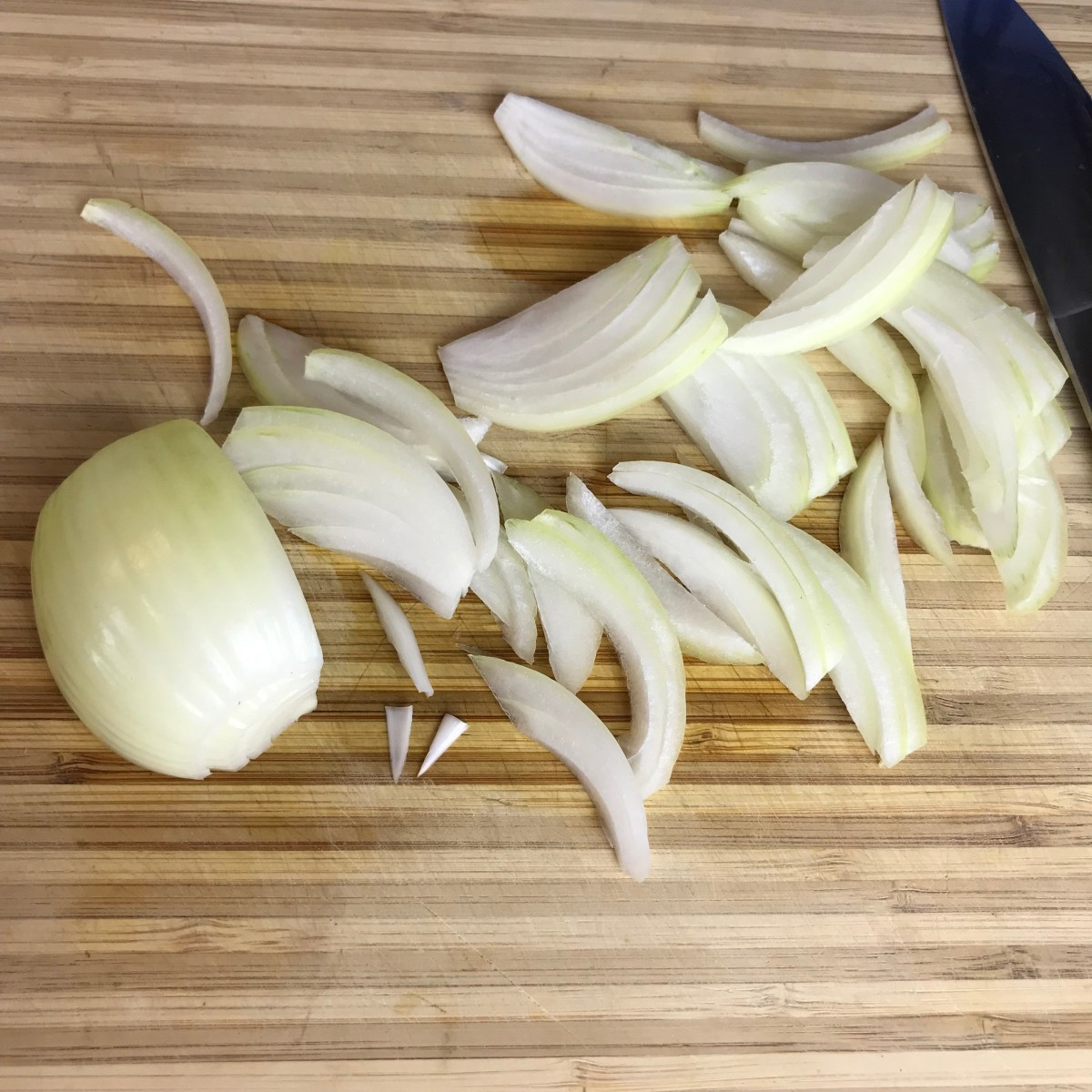 Slice the onions about a quarter inch thick. Any thinner and the juices will cook out too quickly causing the onions to burn. Any thicker and they won't caramelize properly. When cutting the onions go against the grain just like in the photo.