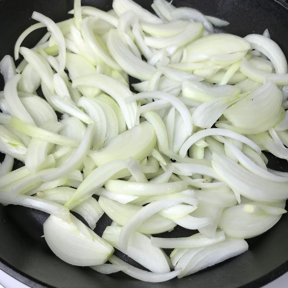 Please don't use a non-stick pan for this if at all possible. It's much better in this instance to use cast iron if you have it, or at least stainless steel. Heat the oil until it's very hot, add the onions, stir, and reduce to low heat.