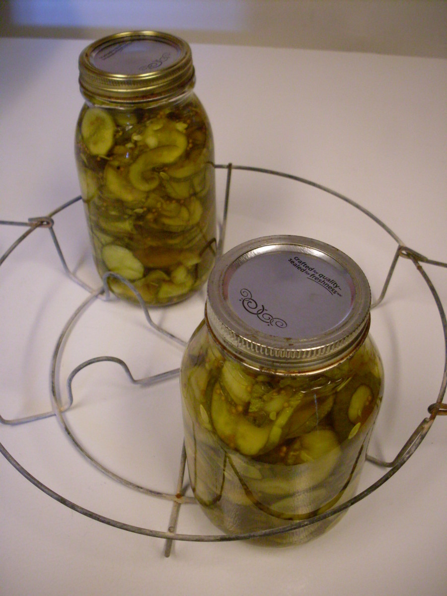 Pack cucumbers and other vegetables into jars fairly tightly. Using a funnel, if you wish, ladle on hot pickling solution, leaving  1/2-inch headspace.