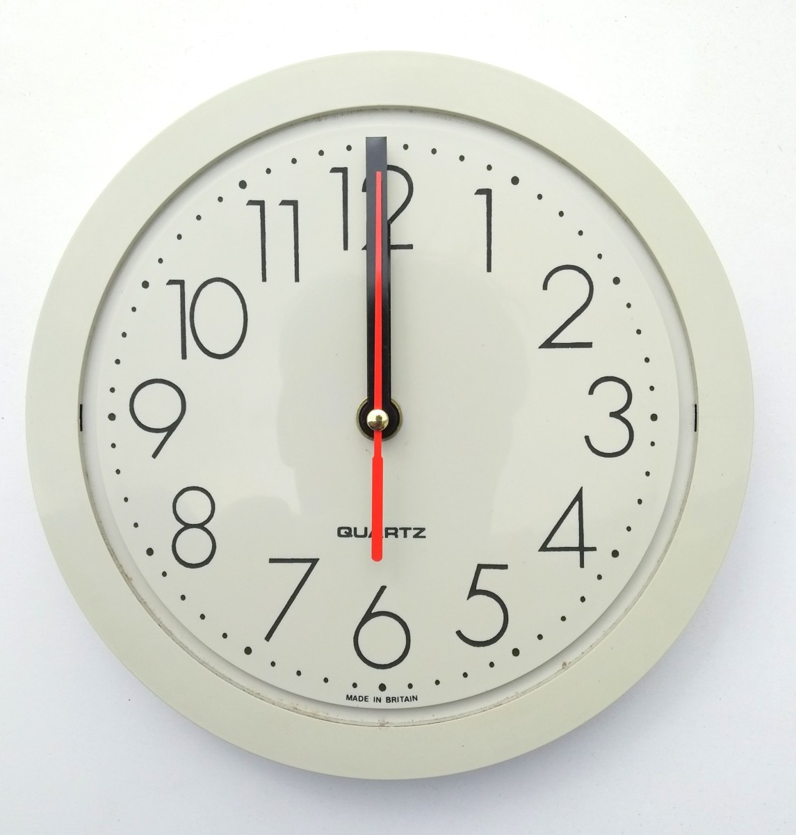 Replace both the hour, minute and second hand (if supplied) and point them all to 12 o'clock. Then set the time after replacing the battery.