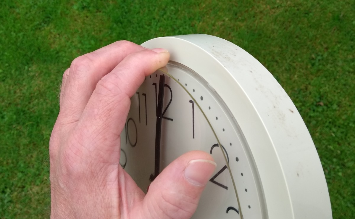 You can detach the lugs of the front cover of some clocks by pushing down with your fingers and pulling out at the same time.
