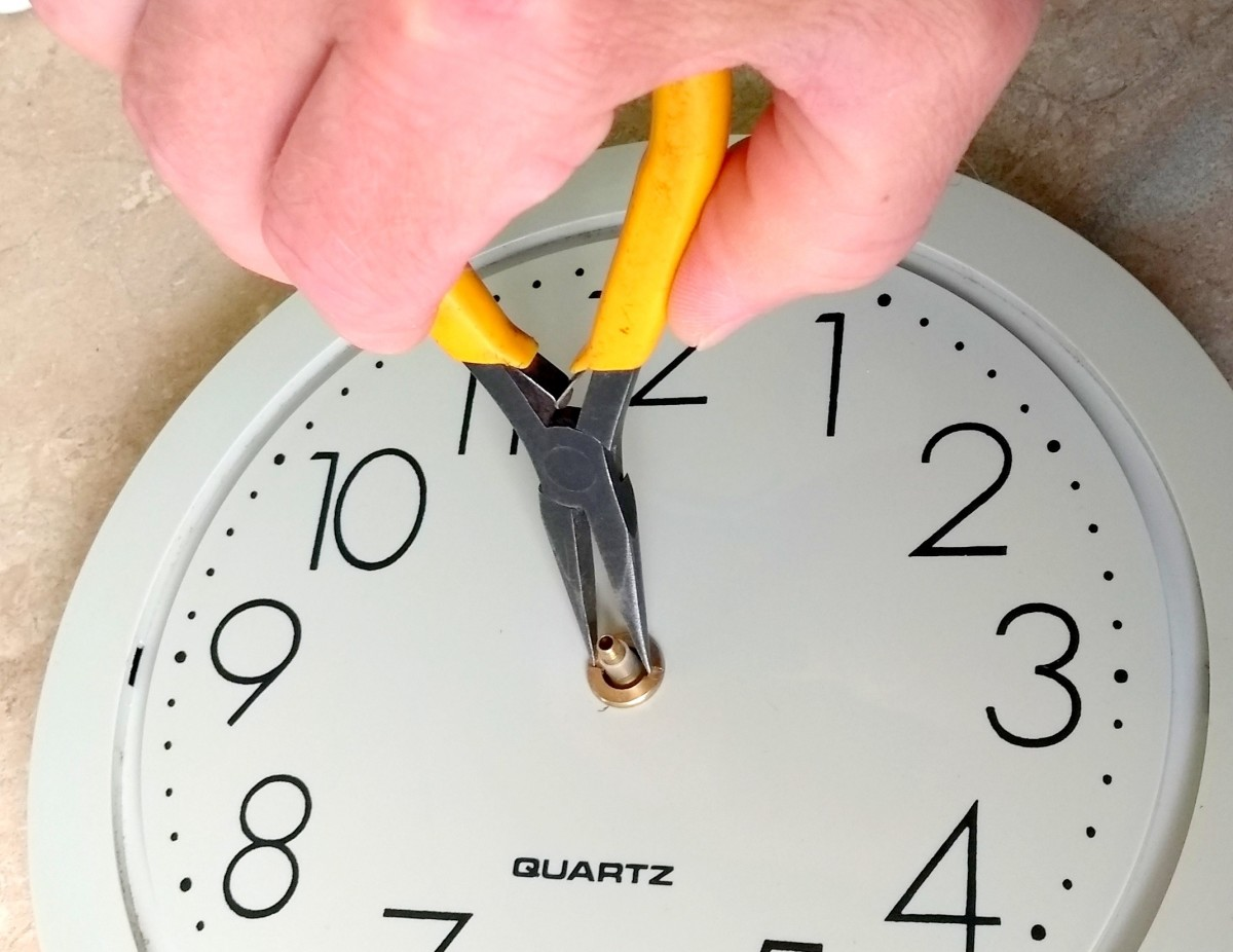Attach the retaining ring for the clock movement. Don't excessively tighten it as it can deform the insides of the movement.