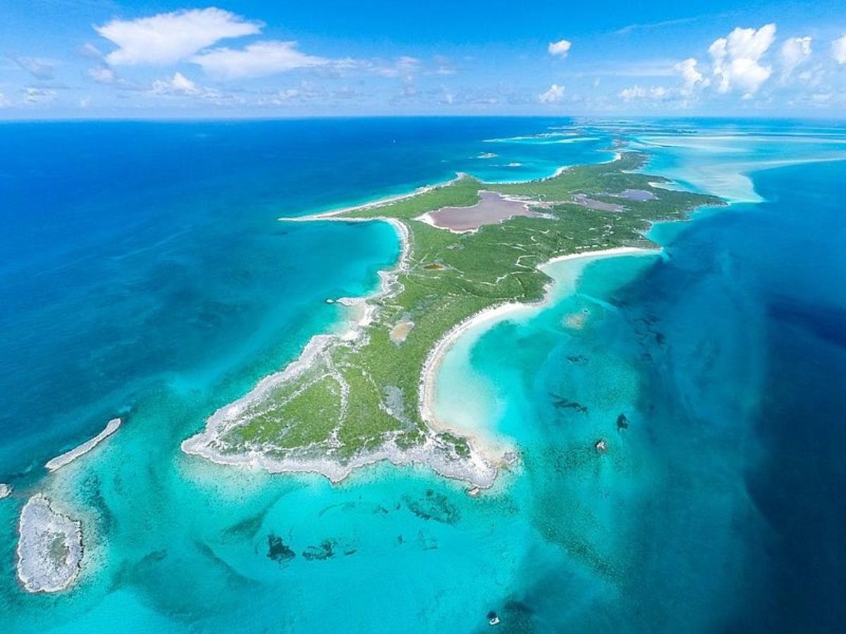 The Cays between the United States, the Bahamas, and Cuba might be beautiful, but I have huge doubts about whether they would be sufficient for water and shelter for an isolated girl sustained only by dolphins.
