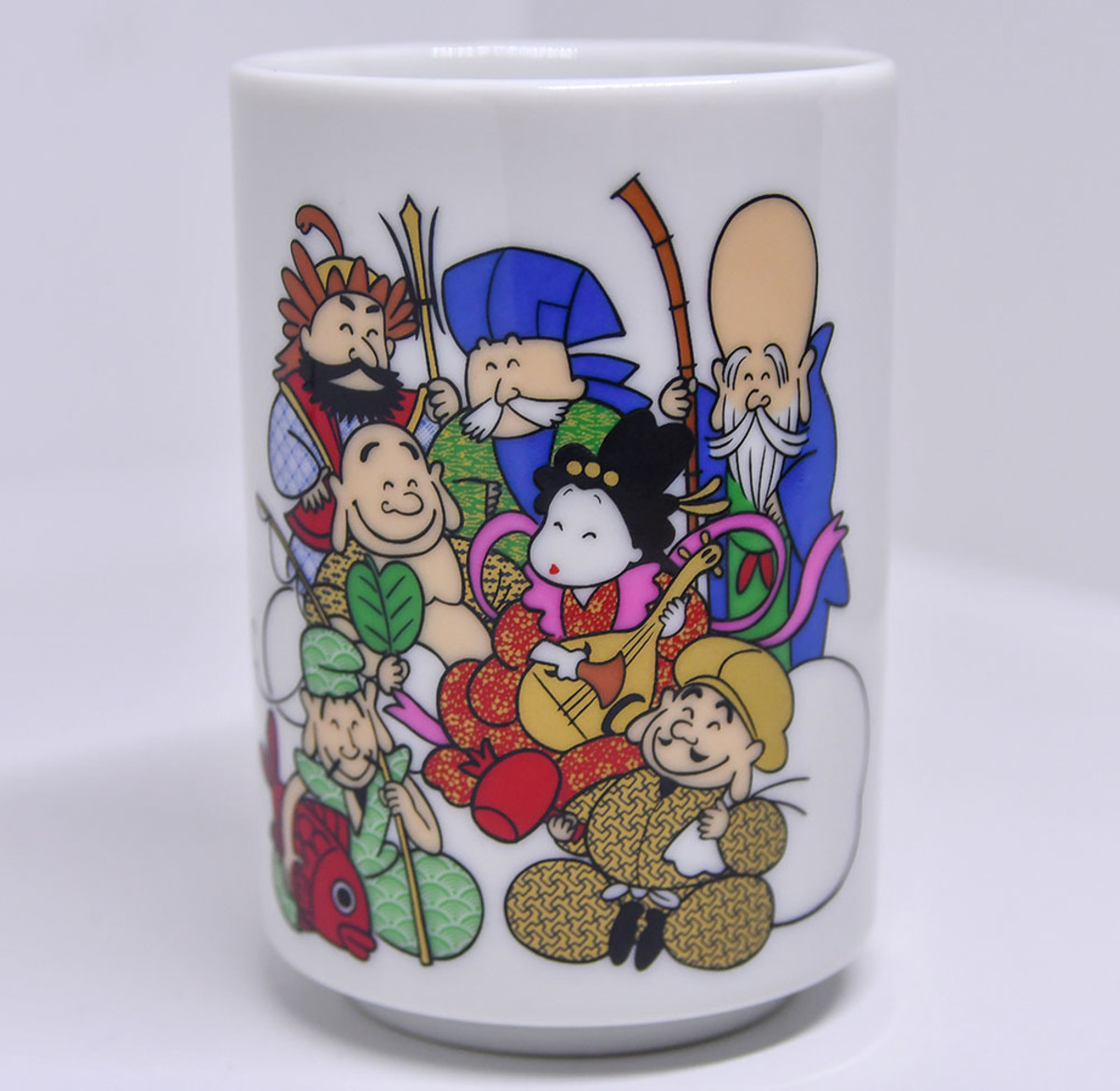 Tea cup with illustration of the Seven Lucky Gods. Can you tell who is who?