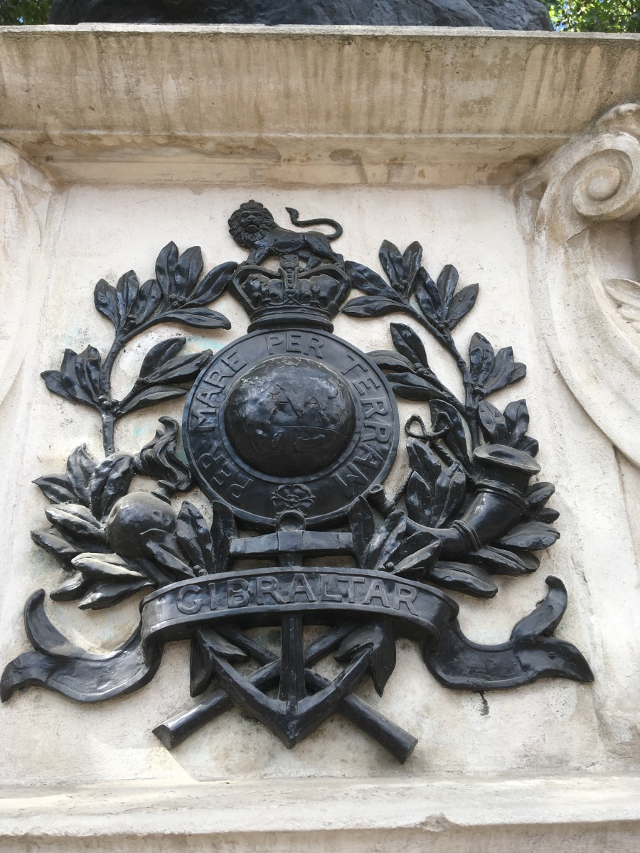 Emblems of the Royal Marines - The Globe and Laurel - also the bomb and horn of the artillery and light infantry which were abolished in 1923.
