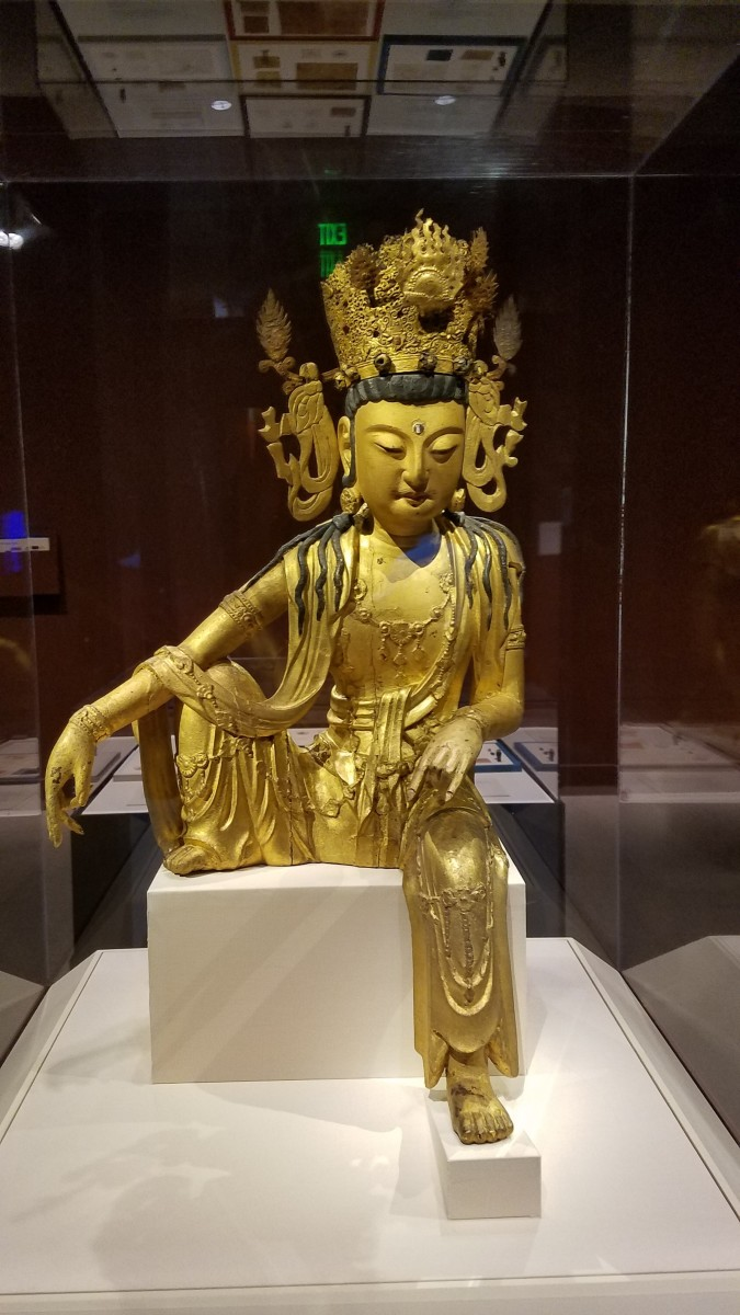 A 13th century CE Korean statue made of gilt wood, copper, and iron with crystal inlays.