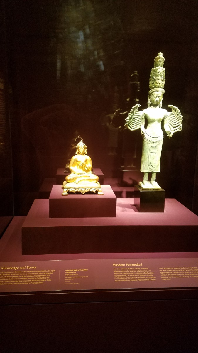 two Buddha statuettes.  One depicts Knowledge and Power, the other is wisdom personified.