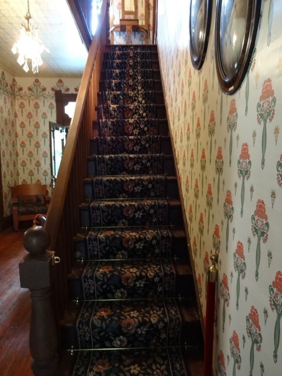 Located directly behind the entry foyer, the narrow stairs lead to the second story.