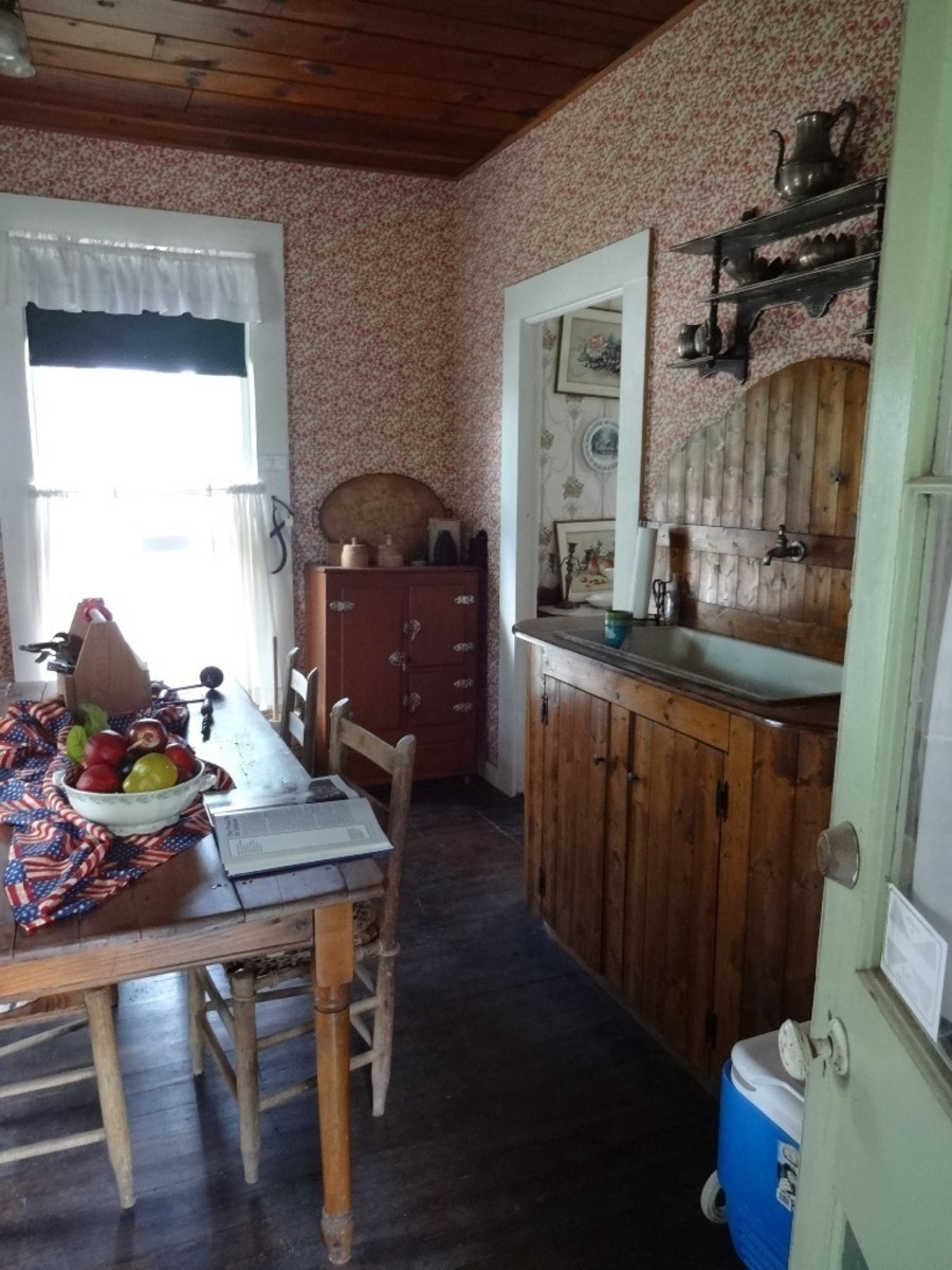 The informal dining room and food preparation area. An old ice box is located in the corner.