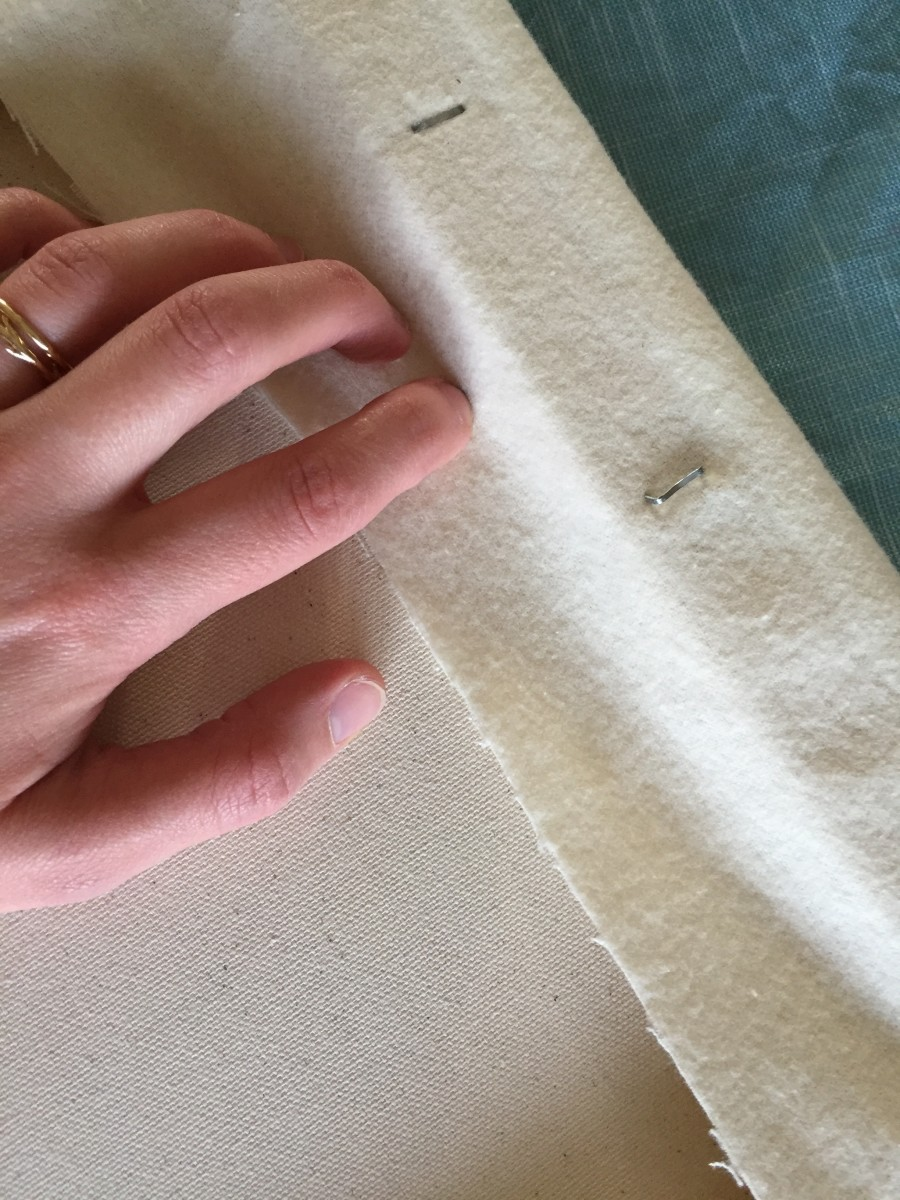 Step 3- Once the flannel was trimmed, we could start stapling along the wood frame of the artist's canvas. Here's a staple that didn't make it all of the way in. No big deal. If this happens just pry it out and try in a different spot.